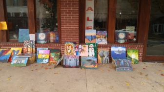 Selling donated paintings at the Christmas parade