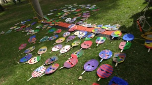 Painted masks laid out to dry at Waco Cultural Arts Fest